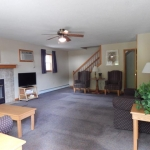1,800 Sq. ft., 4 bedroom townhouse - Living area with stairs and coffee table