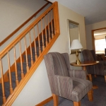 2,000 sq. ft. townhouse with 4 bedrooms - Staircase and chairs